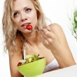 Healthy sexy woman with salad on white background — Stock Photo