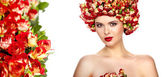 Beautiful girl with hairstyle of rose flowers — Stock Photo
