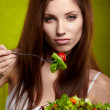 Stock Photo: Female of cute appearance eats vegetable vegetarisalad