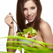 The beautiful cheerful young woman has breakfast salad — Stock Photo #10230066