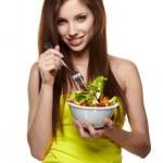 The beautiful cheerful young woman has breakfast salad — Stock Photo