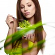 The beautiful cheerful young woman has breakfast salad — Stock Photo #10399597