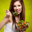 Female of cute appearance eats vegetable vegetarian salad — Stock Photo