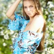 Beautiful woman standing near the apple tree - Stockfoto