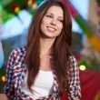 Smiling woman in amusement park. - Stock Photo