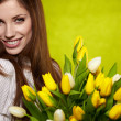 Woman with colorful tulip bouquet - Stock Photo