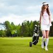 A pretty woman golfer on the putting green — Stock Photo #7985422