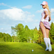 Portrait of an elegant woman playing golf on a green — Stock Photo #7985572