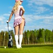 Portrait of an elegant woman playing golf on a green — Stock Photo #7985630