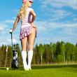 Portrait of an elegant woman playing golf on a green — Stock Photo