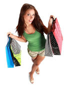 Beautiful, young, woman with colorful shopping bags in her hand — Stock Photo