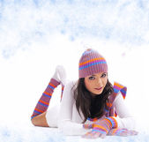 Winter fashion girl over abstract round modern design background — Stock Photo
