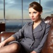 Business woman in modern glass interior — Stock Photo #8328808