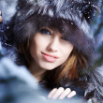 The beautiful woman in winter wood — Stock Photo #8385500