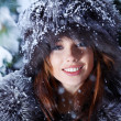 The beautiful woman in winter wood — Stock Photo #8385595