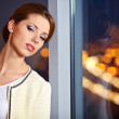 Business woman in an office environment with large stained-glass — Stock Photo #8386131