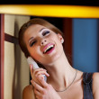 Royalty-Free Stock Photo: A young woman flirting and chatting on the phone