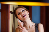 A young woman flirting and chatting on the phone — Stock Photo