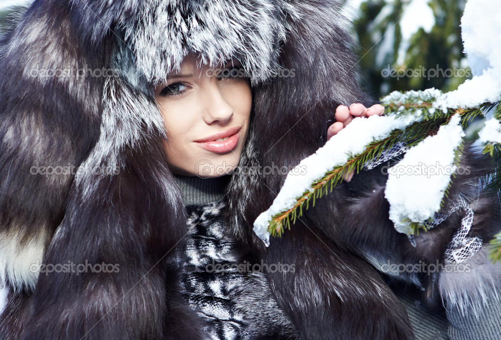 Beauty woman in the winter scenery  Stock Photo #8461795