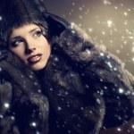 Beautiful woman in a fur coat — Stock Photo #8525898