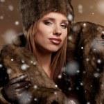 Beautiful woman in a fur coat — Stock Photo #8525980