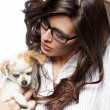 Beautiful young brunette woman with her dog — Stock Photo #8534177