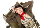 Pin-up image of sexy lovely brunet in military form — Stock Photo