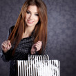 Beautiful woman with shopping bags — Stock Photo