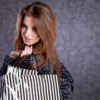Beautiful woman with shopping bags — ストック写真