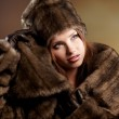 Attractive woman in brown fur coat with hood — Stock Photo #8564733