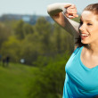 Smiling fitness woman.Park background — Stock Photo #8635087