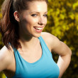Smiling fitness woman.Park background — Stock Photo #8635385