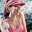 Smiling fitness woman.Park  background - Foto Stock