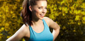 Smiling fitness woman.Park background — Stock fotografie
