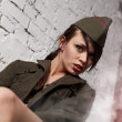 Beautiful girl in military clothes. studio shot — Stock Photo #8754411