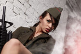 Beautiful girl in military clothes. studio shot — Stock Photo