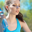 Beautiful Fitness Woman Drinking Water — Stock Photo #8775544
