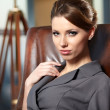 Royalty-Free Stock Photo: Elegant businesswoman in a office interior