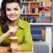Beautiful young college student on a cafe. — Stock Photo #9012025