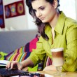 Beautiful young college student on a cafe. — Stock Photo