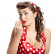 Royalty-Free Stock Photo: Pin-up  woman applying her make-up