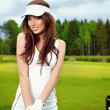 Portrait of an elegant woman playing golf on a green — Stock Photo #9221997