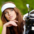 Portrait of an elegant woman playing golf on a green — Stock Photo #9222227