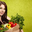 Happy young woman with vegetables. — Stock Photo #9546972