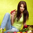 Happy young woman with vegetables. — Stock Photo #9547235