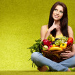 Happy young woman with vegetables. — Stock Photo #9547447