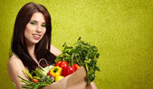 Happy young woman with vegetables. — Stock Photo
