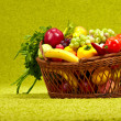 Fresh vegetables in basket  on green background — Stock Photo