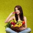Happy young woman with vegetables. — Stockfoto