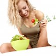 Young happy woman making salad — Stock Photo